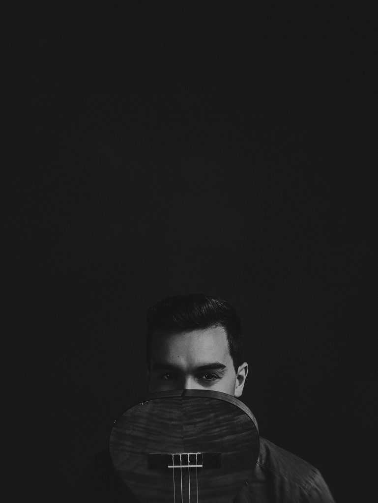 black and white portrait of male musician taken at Cowra NSW Australia photography studio