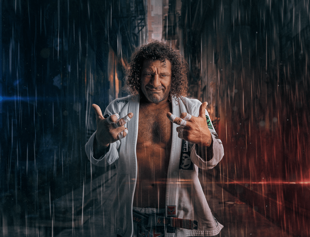 Kurt Osiander standing in the rain giving double rude fingers by Brent Young Photography
