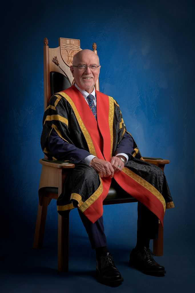 sitting portrait of CSU Deputy Chancellor taken at Bathurst NSW University by Central West Photographer Brent Young