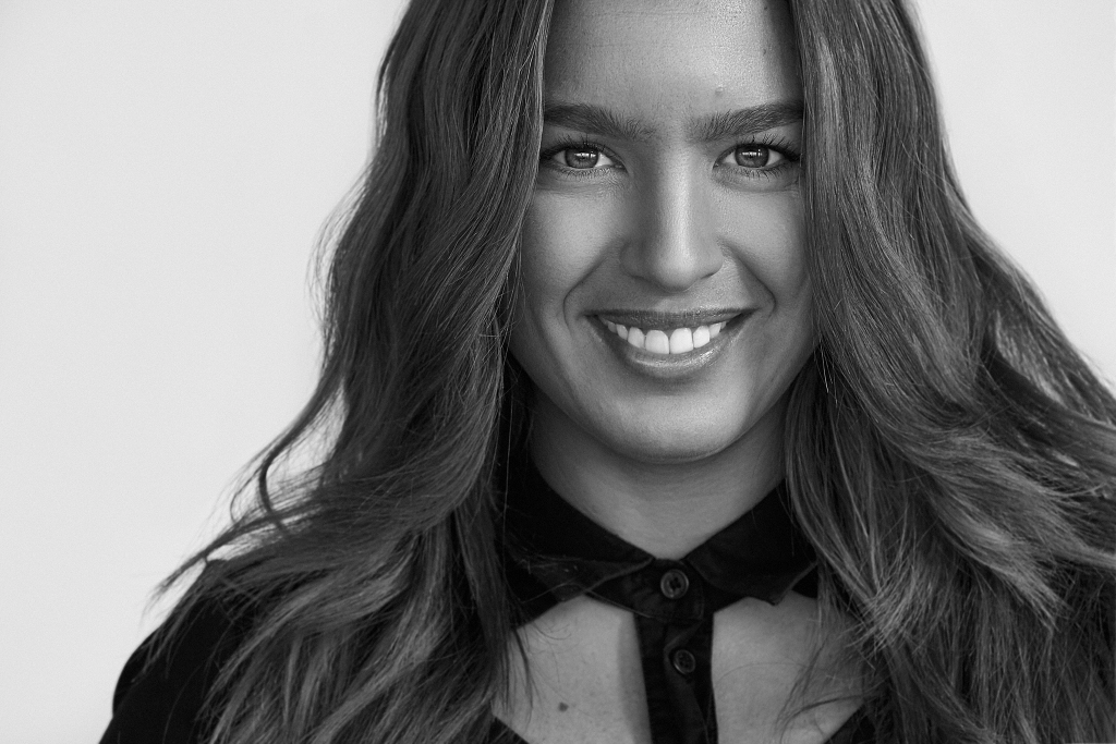black and white portrait headshot of female vocal coach hayley milano at Vaucluse